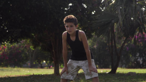 Young boys playing soccer game in park Stock Video Footage