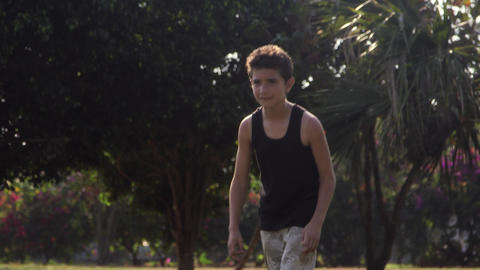 Young boys playing soccer game in park Footage