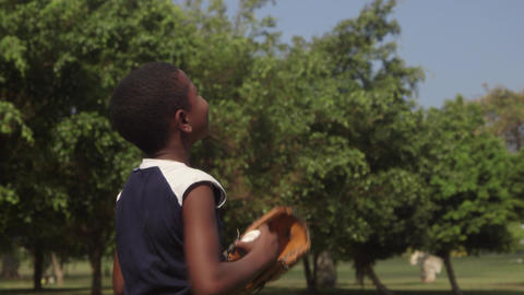 Happy black child playing baseball in park Stock Video Footage