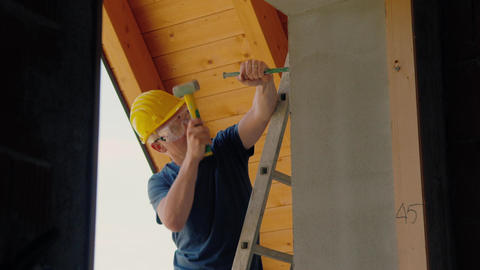 Construction Worker on Stairs Using Hammer Stock Video Footage