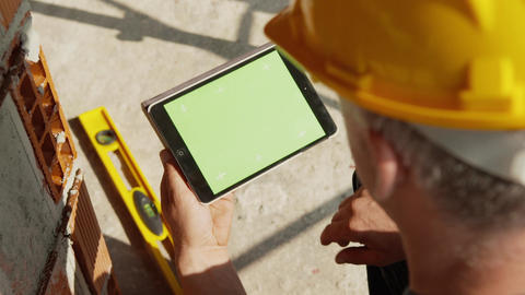 Construction Worker Using Tablet Pc with Green Screen Footage