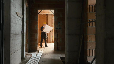 Architect Standing in House Under Construction with... Stock Video Footage