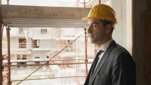 Portrait of Architect with Helmet in Construction site Stock Video Footage