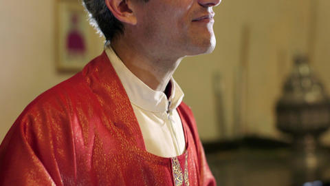 Catholic Priest on Altar in Church Talking and Smiling Stock Video Footage