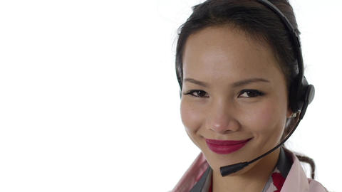 Asian Businesswoman with Headset on White Background Footage