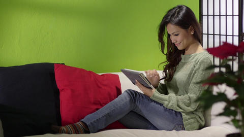 Asian Girl with Digital Tablet on Sofa at Home Stock Video Footage