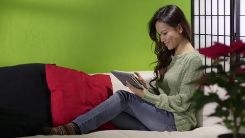 Asian Girl with Digital Tablet on Sofa at Home Footage