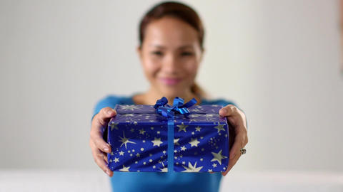 Asian Girl Holding Christmas Gift Stock Video Footage