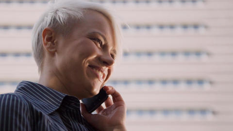 Business Woman Standing Near Office and Talking on phone Footage