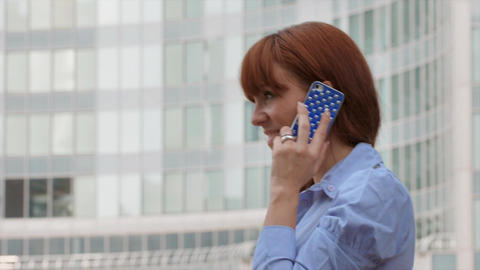 Happy Businesswoman Talking on Mobile Phone Near Office... Stock Video Footage