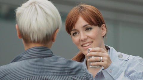 Two Friendly Businesswomen Chatting During Coffee break Stock Video Footage