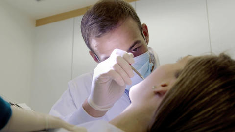 Dentist and Assistant Checking Dental Hygiene of Female... Stock Video Footage