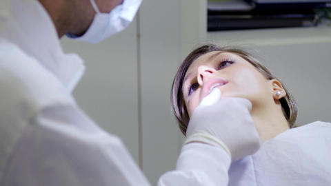 Dentist Inspecting Mouth and Dental Hygiene of Female... Stock Video Footage