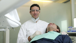 Dentist Visiting Patient in Dental Studio Stock Video Footage