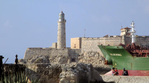 Boat Leaving La Habana Cuba with Castle and Lighth ビデオ