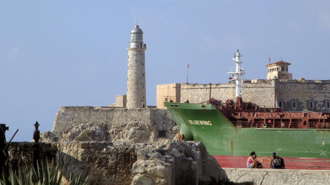 Boat Leaving La Habana Cuba with Castle and Lighth Stock Video Footage