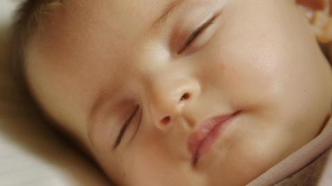 Female Newborn Sleeping in crib Footage