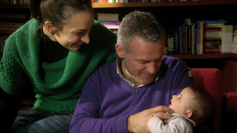 Family Portrait with Adult Couple Playing with Little baby Stock Video Footage