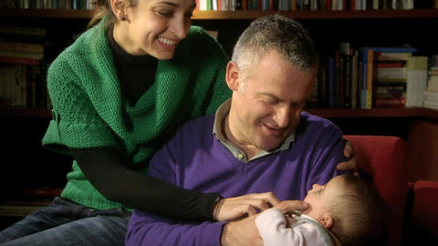Family Portrait with Adult Couple Playing with Little baby Footage