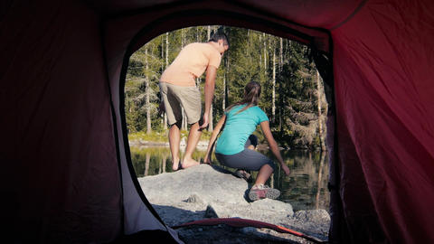 Couple Camping with Tent Near Mountain Lake Stock Video Footage