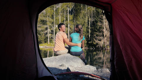 Couple Camping with Tent Near Mountain Lake Footage