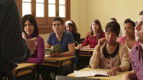 Teacher Speaking To Students During Class in College Stock Video Footage