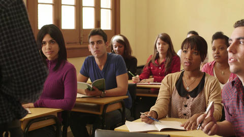 Teacher Speaking To Students During Class In Colle stock footage