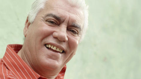 Portrait Of Elderly Man With White Hair Smiling stock footage