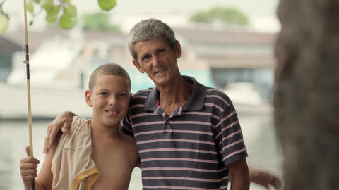 Portrait of Boy and Grandpa Hugging Footage