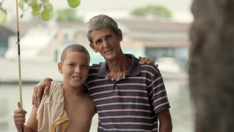 Portrait of Boy and Grandpa Hugging Stock Video Footage