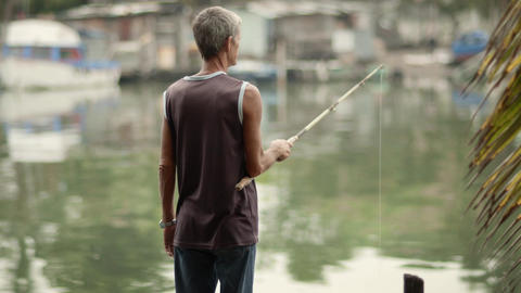 Senior Man Fishing On River stock footage
