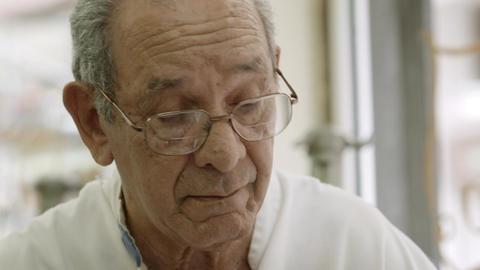 Elderly Barber Shaving Senior Man in Old Fashion S Stock Video Footage
