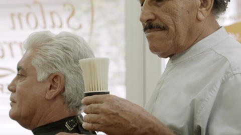 Old Barber Blowing on Brush and Smiling Slow Motio Stock Video Footage