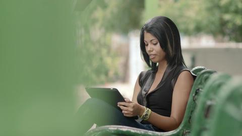 Hispanic Woman Typing on Digital Tablet Pc Stock Video Footage