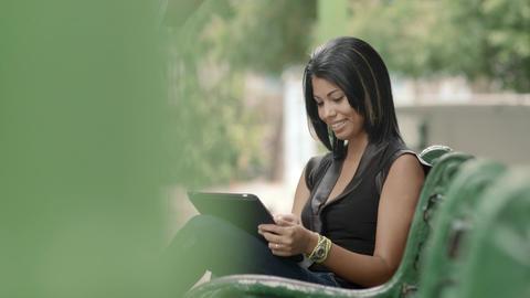 Hispanic Woman Typing on Digital Tablet Pc Footage