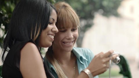 Women Looking at Pictures on Snapshot Camera Stock Video Footage