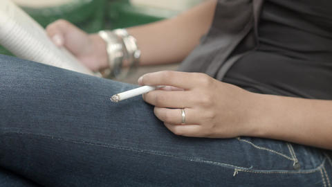 Young Woman with Book Smoking Cigarette Footage