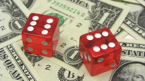 Red Dice on Dollars Stock Video Footage