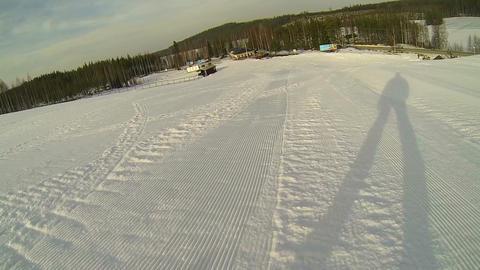 Snowboarding beginner sliding down the slope Stock Video Footage