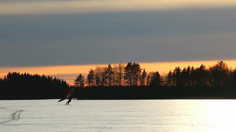Kitewing skier speedup on sunset lake Footage