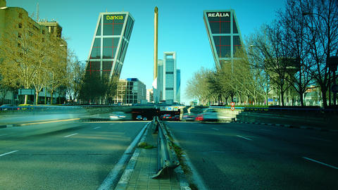 Two buildings form gate over road,in Madrid, Spain Stock Video Footage