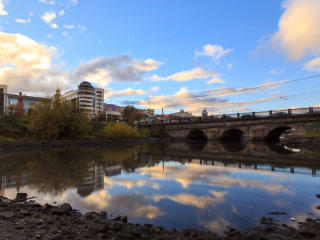 Clouds at sunset on background bridge. Time Lapse. Stock Video Footage