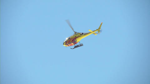 helicopter yellow fly over mountain 01 Stock Video Footage