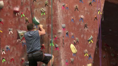 Man Climbing a Rock Wall Stock Video Footage