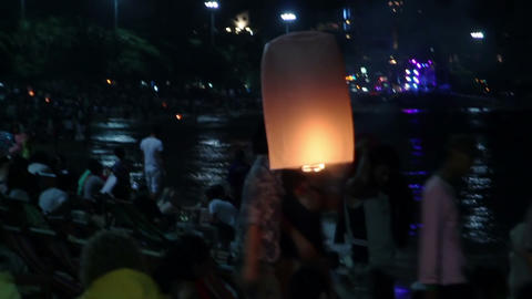 People are releasing hot air chinese sky lanterns Footage
