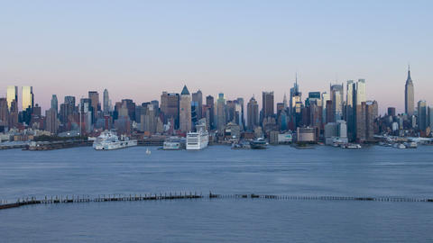 Dusk to night view of Midtown Manhattan across the Footage