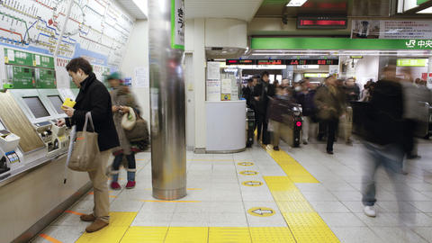 T/L Commuters buying subway tickets from ticket ma Footage