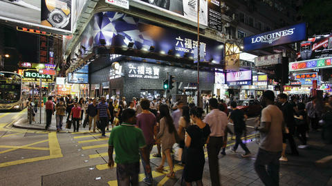 Pedestrians and traffic on Hennessy Road near Time Footage