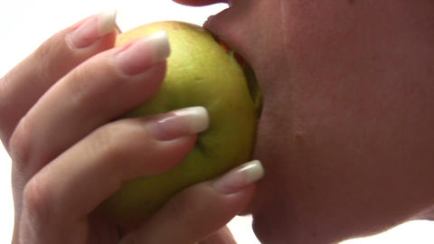 Eating An Apple stock footage