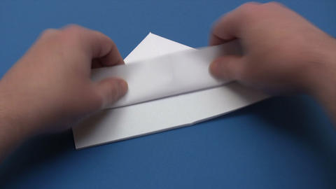 Folding A Paper Boat - Time Lapse stock footage